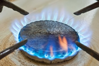 Blue flames from burner