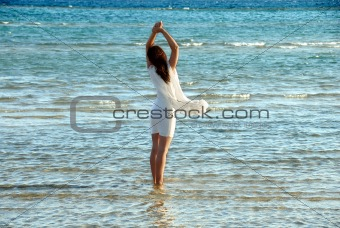 Woman in white dress in sea