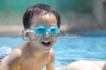 happy asian kid in swimming pool