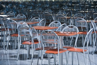 a lot of chairs and tables in fast food cafe