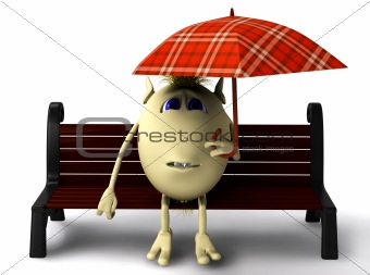Puppet hide itself under umbrella from rain