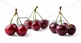 Three groups of juicy cherries