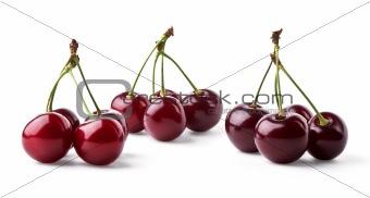 Three groups of juicy cherries