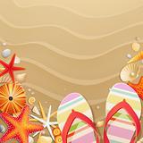 Flip-flops and shells on sand background