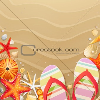 Flip-flops and shells on sand background