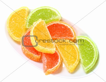 Group of sweets as citrus fruits on white plate