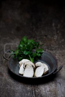 slices of boletus mushrooms in a pan