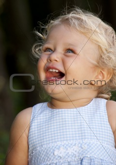 Blond baby girl laughing