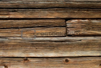 Old wooden log house wall