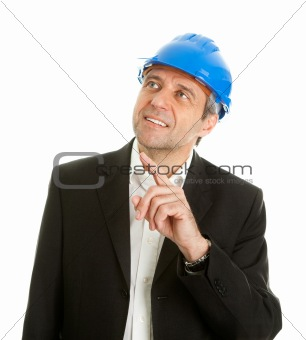 Portrait of successfull architect wearing blue hard hat and pointing