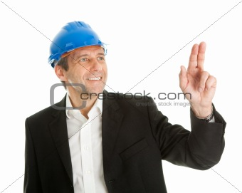 Portrait of successful architect pointing