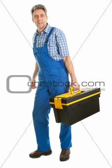 Confident service man standing with toolbox
