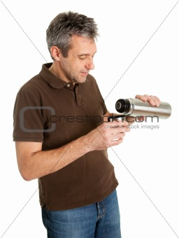 Portrait of senior man drinking coffee/tea from thermos