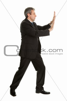 Portrait of business man pushing copy-space