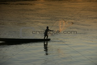 A fisherman on the Mekong