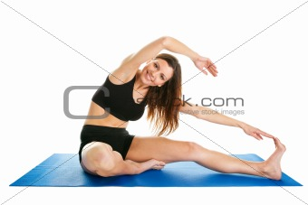 Fitness woman stretching on gym mat