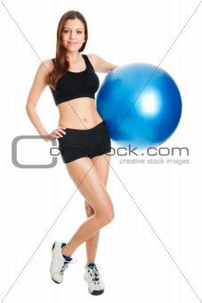 Fitness woman posing with fitness ball