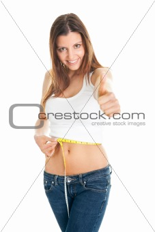 Beautiful woman measuring waist