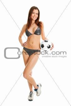 Beautilful woman in bikini posing with soccer ball