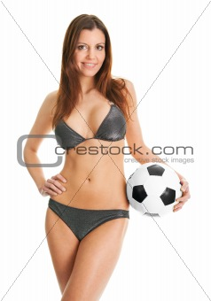 Beautilful woman in bikini posing with soccer ball