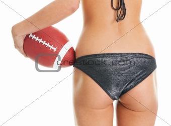 Beautilful woman posing with football ball