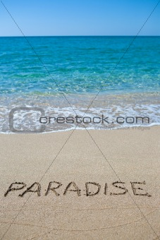 Paradise written on the sand