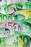 Money background - euro banknotes under lit