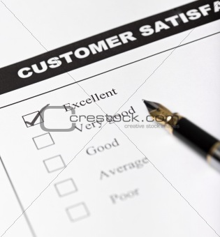 Customer satisfaction survey form with pen - closeup