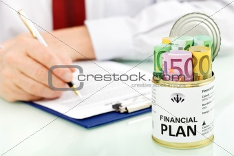 Business man making financial plan - closeup