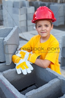 Boy learning the tricks of trade at a construction site