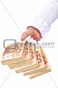 Stacks of euros in woman hand - isolated