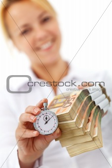 Woman with euro stacks and stopwatch