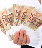 Euro stacks in woman hand