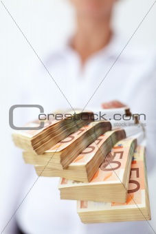 Stack of euro banknotes handed to you