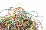 A pile of colorful rubber elastics isolated over white