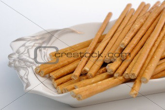 Bread sticks on plate