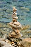 balanced stone structure on rocky shore