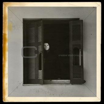 vintage photograph of masked figure