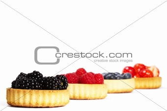 blackberries and other berries in tartlet cakes