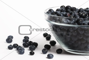 bowl full with a lot of blueberries with some aside