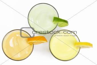 three cold citrus fruit milkshakes from top