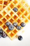 waffles with sugar covered blueberries from top
