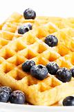 waffles with sugar covered blueberries and syrup
