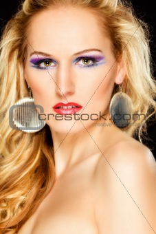 Portrait of attractive woman with extravagant makeup. Retouched