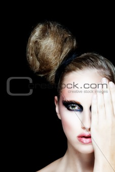 Portrait of pretty girl with hand closing eye. Retouched