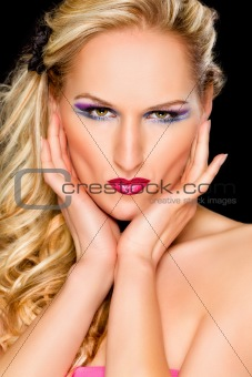 Portrait of beautiful woman with extravagant makeup. Retouched