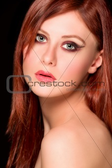 Portrait of beautiful red hair girl. Retouched