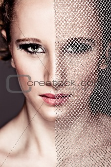 Portrait of tough girl closing face with textile. Retouched