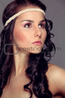 Portrait of beautiful girl looking in corner. Retouched