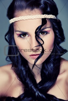 Portrait of beautiful girl with extravagant hair. Retouched